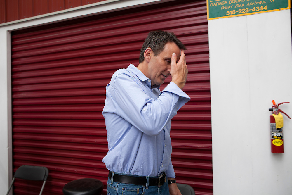 Republican presidential hopeful Tim Pawlenty leaves the Iowa Pork Producers booth at the Iowa State Fair on Friday, August 12, 2011 in Des Moines, IA.