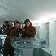 Mongolia. Yurt made with blocks of  Ice. Night bar. during the Ice festival on the frozen Khuvsgul lake  Khuvsgul province