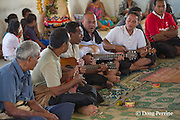 Tongan singing at kava ceremony at homecoming greeting for Aunofo, crew member on Hine Moana, traditional double-hulled Polynesian voyaging canoe or waka, Hunga Village, Hunga Island, Vava'u, Kingdom of Tonga, South Pacific