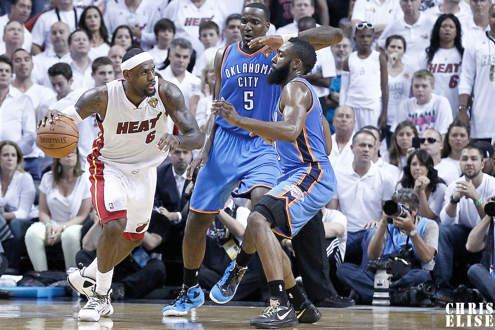 21 June 2012: Miami Heat small forward LeBron James (6) drives past Oklahoma City Thunder center Kendrick Perkins (5) and Oklahoma City Thunder guard James Harden (13) during the second quarter of Game 5 of the 2012 NBA Finals, at the AmericanAirlinesArena, Miami, Florida, USA.