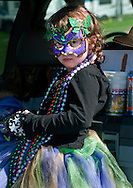 A little girl watches the annual Mardi Gras parade March 6, 2011 in Grand Isle, La. The island was heavily impacted by the Deepwater Horizon oil spill April 20, 2010 and continues to recover. (Photo by Carmen K. Sisson/Cloudybright)