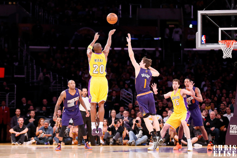 10 December 2013: Los Angeles Lakers shooting guard Jodie Meeks (20) takes a jumpshot over Phoenix Suns shooting guard Goran Dragic (1) during the Phoenix Suns 114-108 victory over the Los Angeles Lakers at the Staples Center, Los Angeles, California, USA.
