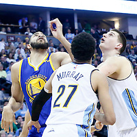 13 February 2017: Golden State Warriors center JaVale McGee (1) vies for the rebound with Denver Nuggets forward Nikola Jokic (15) and Denver Nuggets guard Jamal Murray (27) during the Denver Nuggets 132-110 victory over the Golden State Warriors, at the Pepsi Center, Denver, Colorado, USA.