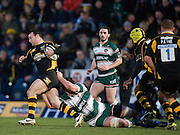 Wycombe, GREAT BRITAIN,   Wasps' Mark ROBIBSON tackled by Tigers' Louis DEACON, during the Guinness Premiership rugby game, London Wasps vs Leicester Tigers at Adam's Park Stadium, Bucks, England, on Sun 15.02.2009. [Photo, Peter Spurrier/Intersport-images]