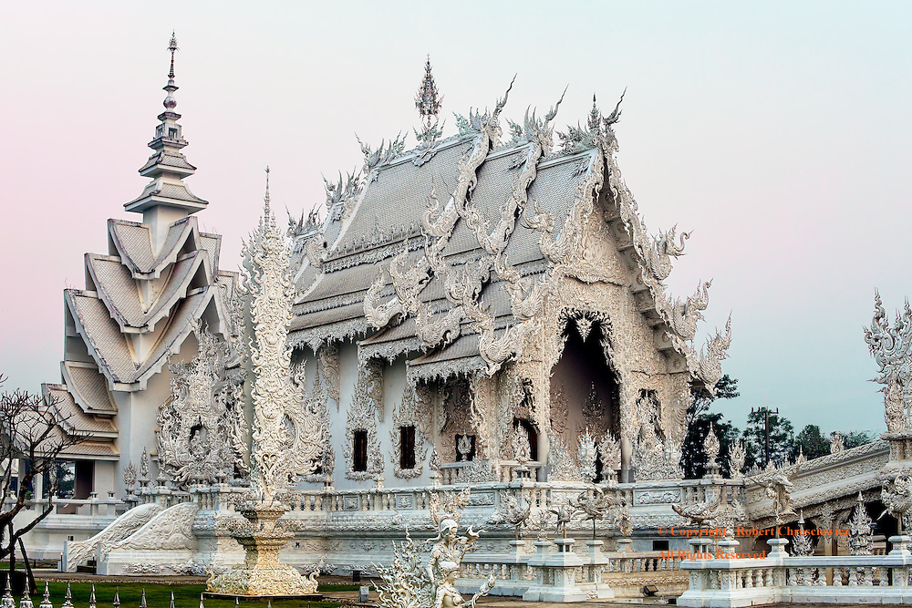 White Temple Morning:  Wat Rong Khun, better known as the White Temple, is both a Hindu and Buddhist temple and is seen in all its elaborate detail at sunrise, Chiang Rai Thailand.