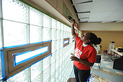 A student volunteer paints the walls of the King-Kennedy Center in Ravenna.