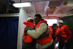 DAVIS STRAIT ABOARD ESPERANZA 16JUN11 - Greenpeace International executive director Kumi Naidoo of South Africa arrives on the Greenpeace ship Esperanza in the Davis Stait off the coast of Greenland...Photo by Jiri Rezac / Greenpeace