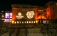 The Wisconsin Union Directorate and Sunburst Festival logos are projected onto the West Wing of Memorial Union at Sunburst Festival in 2014.