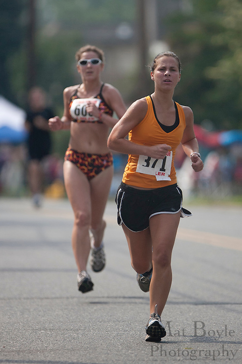 Rowan Univeristy Track and Field runner and West Deptford High School alum, Ashley White runs it Pitman's Freedom 4 Mile run before the Pitman 4th of July Parade.