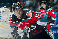 KELOWNA, CANADA - OCTOBER 7: Kris Schmidli #16 of Kelowna Rockets skates against the Swift Current Broncos on October 7, 2014 at Prospera Place in Kelowna, British Columbia, Canada.  (Photo by Marissa Baecker/Getty Images)  *** Local Caption *** Kris Schmidli;