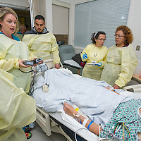 Jennifer Hajj, RN, left, and Angela Thielen of Interpreter services, (with gloves)  explain to patient Eliseo Quiroz, and family the opperation and use of the heart replacement device or Heartware, at Cedars-Sinai Medical Center on Wednesday, April 17, 2013.  Photo by Cedars-Sinai Medical Center