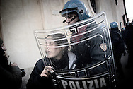 ITALY, Rome :A police officer subdues a demonstrator in Rome, Tuesday, Dec. 14, 2010 during clashes with youths during a protest to demand a change of government as parliament met to hold a crucial vote that could topple Prime Minister Silvio Berlusconi on December 14, 2010 in Rome. Italian Prime Minister Silvio Berlusconi scraped through a crucial confidence vote in the lower house of parliament by 314 votes in favour and 311 against.