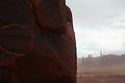 View of the Totem rock in Monument Valley on the southern border of Utah with northern Arizona during a sandstorm. The valley lies within the range of the Navajo Nation Reservation. The Navajo name for the valley is Tsé Bii' Ndzisgaii - Valley of the Rocks.
