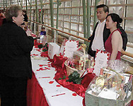 Karen Moore, from Casstown (left) talks to Fuji Le and Yvonne Zhou during the silent auction at the 2007 Wellness Connection Red Dress Gala, at the Schuster Performing Arts Center in Dayton, Saturday night, May 5th.