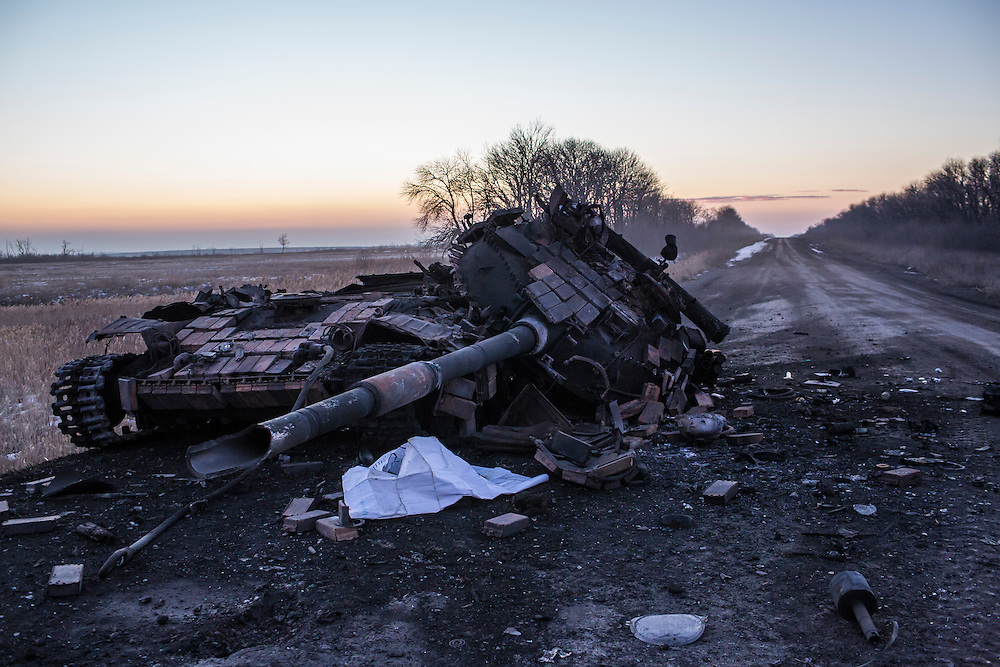 DEBALTSEVE, UKRAINE - FEBRUARY 20: A destroyed tank sits by the road on February 20, 2015 in Debaltseve, Ukraine. Ukrainian forces withdrew from the strategic and hard-fought town after being effectively surrounded by pro-Russian rebels, though fighting has caused widespread destruction. (Photo by Brendan Hoffman/Getty Images) *** Local Caption ***