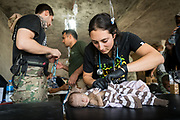 Katie Batrouney, a paramedic from Australia, examines a critically malnourished 2-month old baby at a trauma stabilisation point a kilometre from the frontline on the edge of Mosul's Old City, on June 21, 2017.