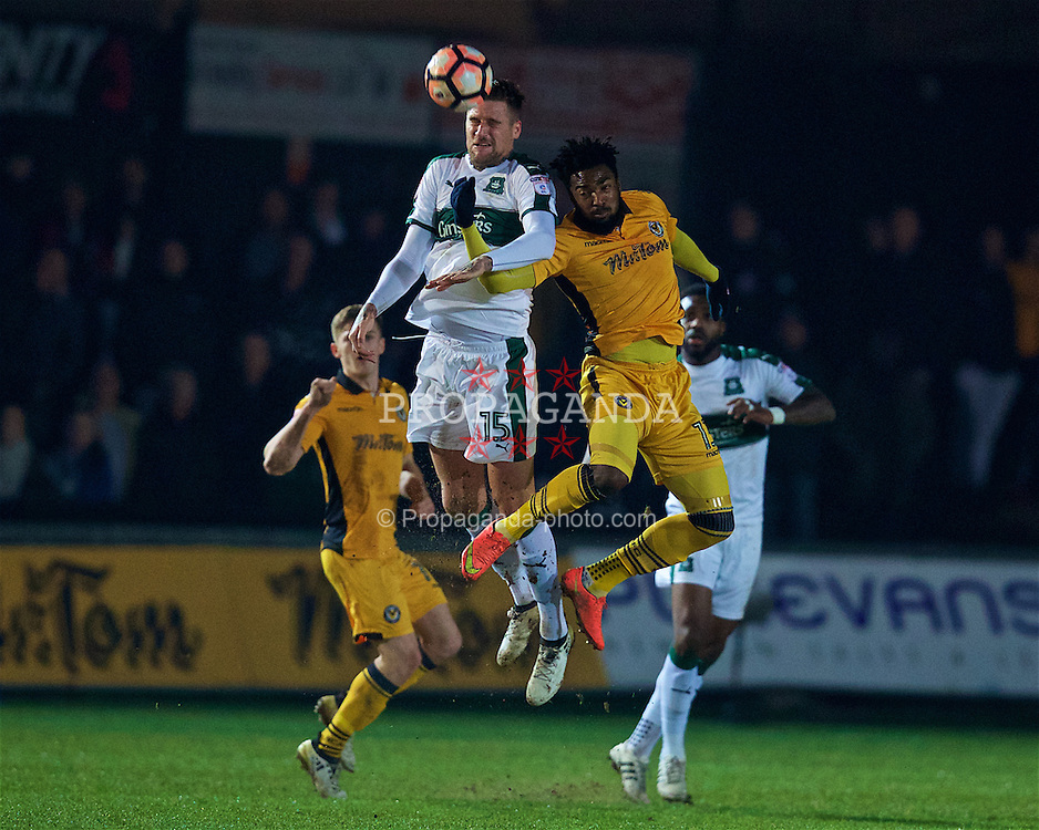 NEWPORT, WALES - Wednesday, December 21, 2016: Newport County's Marlon Jackson [R] and Plymouth Argyle's Sonny Bradley [L] during the FA Cup 2nd Round Replay match at Rodney Parade. (Pic by David Rawcliffe/Propaganda)