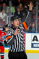 KELOWNA, BC - OCTOBER 2:  Referee Ryan Okeeffe signals to the Kelowna Rockets bench from centre ice against the Tri-City Americans at Prospera Place on October 2, 2019 in Kelowna, Canada. (Photo by Marissa Baecker/Shoot the Breeze)