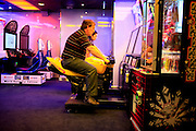 Passengers tests arcade games onboard the cruise ship Oasis of the Seas. The ship, currently the largest in the world, is owned by Royal Carribean Cruise Line.