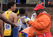 Apr 27, 2018; Philadelphia, PA, USA; USA Track & Field official Michael McCoy reads out lane assignments during a 4  x 100m relay heat at the 124th Penn Relays at Franklin Field.