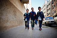 Anass and his twin brother walking early morning to school.