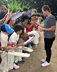 England's Eoin Morgan signs autographs at Merchant TaylorÕs School, Rickmansworth.