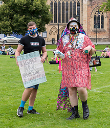 "© Licensed to London News Pictures; 18/07/2020; Bristol, UK. A Trans Rights protest rally takes place on College Green. Speakers include Shon Faye - writer, presenter, editor, artist, comedian and activist<br /> - Travis Alabanza - artist, performer, writer and theatre maker. The protest is one of many taking place across the UK today and is in protest against reported plans by the UK Government to drop reforms to the Gender Recognition Act and to introduce a law that will restrict the rights of trans women to use women's facilities, such as public toilets, changing rooms and refuges. Proposals to reform the Gender Recognition Act (GRA) would allow people to change their legal gender by ""self-identifying"" as male or female and would let transgender people change their birth certificate without a medical diagnosis. But the Government looks set to drop these, despite 70 per cent of responses to a recent consultation of the GRA being in favour of self-identification. Campaigners say the UK Government intends to scrap the GRA reform and roll back the hard-won rights of trans and non-binary people. The Government is also allegedly planning to introduce a law that will restrict the rights of trans women to use women's facilities, such as public toilets, changing rooms and refuges. The event is calling for trans people to be able live their lives without being subjected to discrimination and abuse. Photo credit: Simon Chapman/LNP."