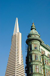 California: San Francisco, North Beach. Historic Zoetrope Building with Transamerica Pyramid in backgrond. Photo #: san-francisco-north-beach-18-casanf79321. Photo copyright Lee Foster.
