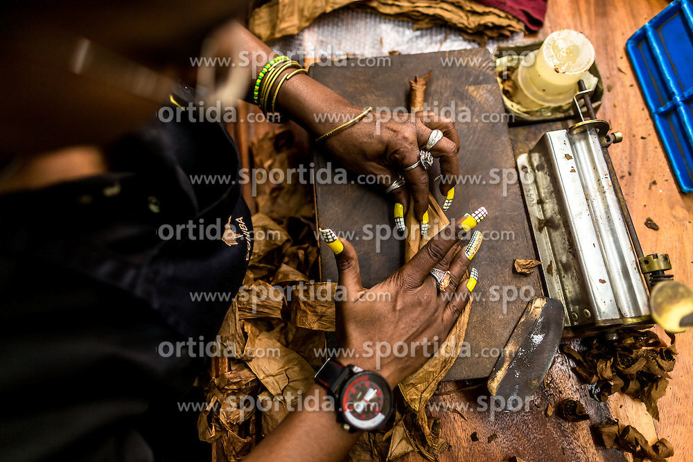 "A worker makes Cohiba cigar at the ""El Laguito"" factory in Havana, capital of Cuba, on March 3, 2016. Cohiba is the flagship brand of Cuban cigar. It was first created in 1966 for Cuban revolutionary leader Fidel Castro himself and was then top secret. It soon became Cuban gifts for heads of state and visiting diplomats. Since 1982 Cohiba has been available in limited quantities to the open market. The name ""Cohiba"" is an ancient Taino Indian word for the bunches of tobacco leaves that Columbus first saw being smoked by the original inhabitants of Cuba. EXPA Pictures © 2016, PhotoCredit: EXPA/ Photoshot/ Liu Bin<br />