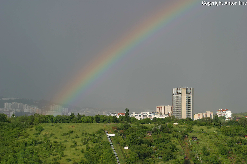 Rainbpw over one of tallest buildings in Bratislava - National public TV building (Slovenska televizia). The picture was taken from Dlhe Diely estate housing.