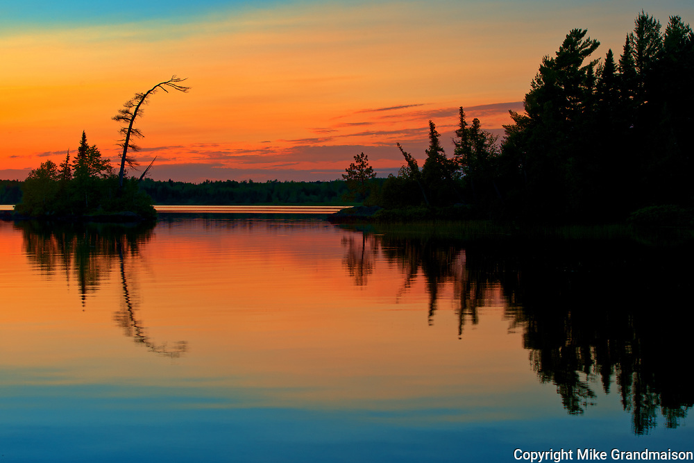 Reflection on Lac des Sables at sunset<br />