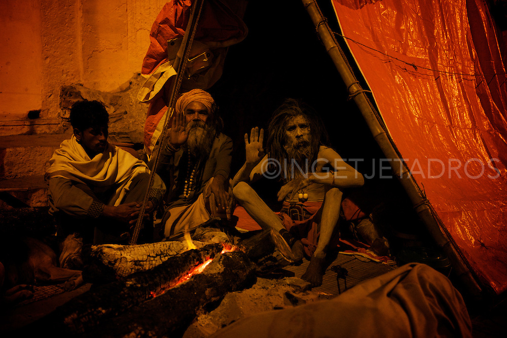 Very early in the morning while walking along the Ganges I met Baba Mehand Bidjegri, who is a Naga Sadhu, aged 43 yrs old.<br /> Born in Kolkata of the Atjaria Caste (Braham) which is a high caste, his father was a Sadhu and all male members in his family are Sadhus.<br /> Baba G as he calls himself is celebate and vowed to leave everything but mentioned he has no objection to alcohol and drugs.<br /> Baba G lives everywhere and has no belongings, he moves around all the time and as a child ( 9 yrs.) he did the 'childroute' and lived in various Ashrams where he learned to read and write while his family supported him.<br /> The only thing he always carrys with him is a plastic bag with Babud (human ashes) which he rubs over his whole body to protect him from the cold.<br /> <br /> In Hinduism, Sadhu means a good man, a holy man, a wondering monk.<br /> Most Sadhus are yogi's but not all yogi's are Sadhus<br /> The Sadhu is solely dedicated to achieving liberation, the fourth and final 'asrama' (stage of life), through meditation and contemplation.<br /> Sadhus often wear saffron-colored clothing, symbolizing their 'sanyasa' (reincarnation) &copy;Ingetje Tadros