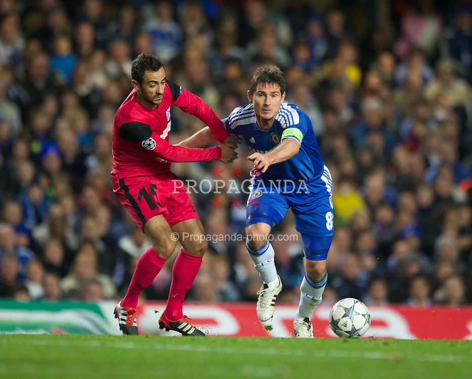 LONDON, ENGLAND - Wednesday, October 19, 2011: Chelsea's Frank Lampard in action against Racing Genk's Fabien Camus during the UEFA Champions League Group E match at Stamford Bridge. (Photo by Chris Brunskill/Propaganda)