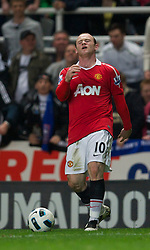 NEWCASTLE, ENGLAND - Tuesday, April 19, 2011: Manchester United's Wayne Rooney looks dejected during the Premiership match against Newcastle United at St James' Park. (Photo by David Rawcliffe/Propaganda)