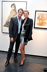 TIM & MALIN JEFFERIES at a private view of photographs by Herb Ritts held at Hamiltons Gallery, 13 Carlos Place, London on 21st June 2011.