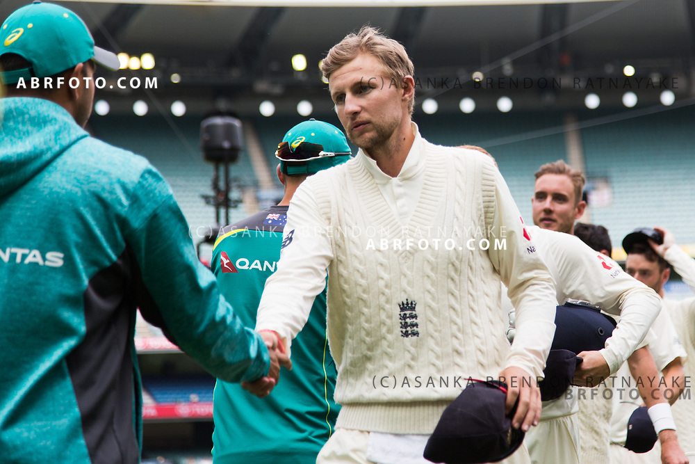 Joe Root shakes hands with the Australian at the end as the match played out to a draw during day 5 of the 2017 boxing day test.