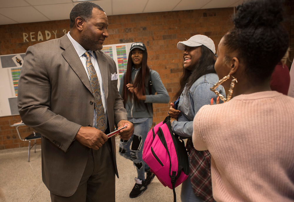 Superintendent Dr Anthony Hamlet is recognized by students Demetress Wright and Savannah Penn during a visit to Brashear High School for instructional review.