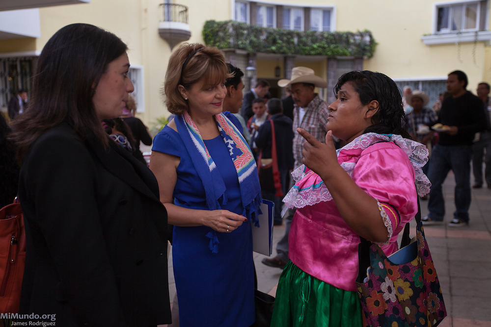 Stella Zervoudaki (center in blue), ambassador of the European Union to Guatemala, speaks with Elodia Castillo, from COMUNDICH, as members from thirty-three local human rights organizations hold a special meeting with ambassadors and representatives from the European Union missions in Guatemala. Guatemala City, Guatemala, June 4, 2014.