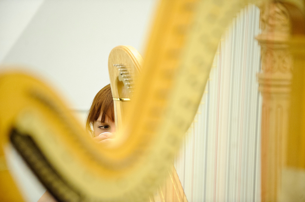 (photo by Matt Roth).Assignment ID: 30127886A..Baltimore Symphony Orchestra harpist Sarah Fuller sips coffee during harp chamber practice during the third annual BSO Academy at the Baltimore School for the Arts Sunday, June 24, 2012. ..