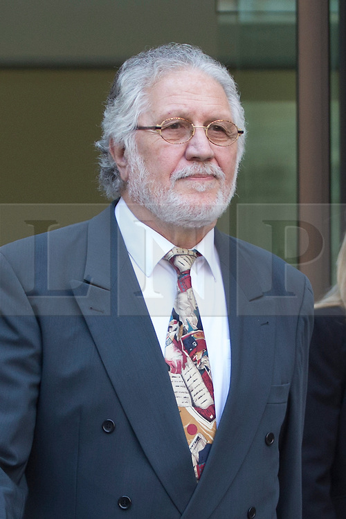 © licensed to London News Pictures. London, UK 23/08/2013. DJ Dave Lee Travis, whose real name is David Patrick Griffin, leaving Westminster Magistrates Court after making his first appearance in court. He has been charged with 11 counts of indecent assault and one of sexual assault against alleged victims aged between 15 and 29 between 1977 and 2007. Photo credit: Tolga Akmen/LNP