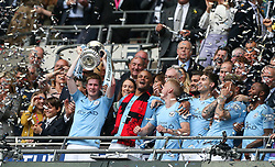 Kevin De Bruyne lifts the trophy in celebration - Mandatory by-line: Arron Gent/JMP - 18/05/2019 - FOOTBALL - Wembley Stadium - London, England - Manchester City v Watford - Emirates FA Cup Final