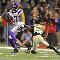 Jan 24, 2010; New Orleans, LA, USA; Minnesota Vikings wide receiver Bernard Berrian (87) avoids New Orleans Saints cornerback Tracy Porter (22) during the first quarter of the 2010 NFC Championship game at the Louisiana Superdome. Mandatory Credit: Derick E. Hingle-US PRESSWIRE