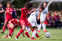 WREXHAM, WALES - Thursday, August 15, 2019: Cyprus' Alexandros Argyrou and Malta's Jayden Ohaka during the UEFA Under-15's Development Tournament match between Cyprus and Malta at Colliers Park. (Pic by Paul Greenwood/Propaganda)