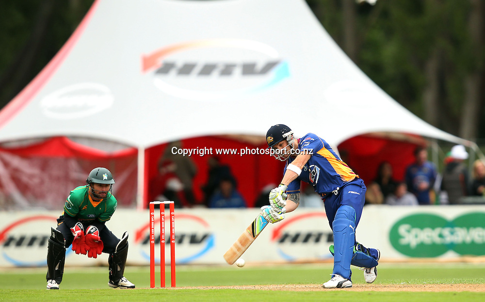 Brendon McCullum looks to play through cover for the Volts.<br /> Twenty20 Cricket - HRV Cup, Otago Volts v Central Stags, 18 December 2011, University Oval, Dunedin, New Zealand.<br /> Photo: Rob Jefferies/PHOTOSPORT