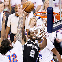 06 May 2016: San Antonio Spurs forward Kawhi Leonard (2) takes a jump shot over Oklahoma City Thunder center Steven Adams (12) during the San Antonio Spurs 100-96 victory over the Oklahoma City Thunder, during Game Three of the Western Conference Semifinals of the NBA Playoffs at the Chesapeake Energy Arena, Oklahoma City, Oklahoma, USA.