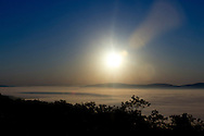 Gardiner, New York - The Wallkill Valley is covered in fog shortly after sunrise as seen from the Shawangunk Ridge in Gardiner, New York.