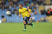 Oxford United midfielder Kemar Roofe (4) breaks forward during the Sky Bet League 2 match between Oxford United and AFC Wimbledon at the Kassam Stadium, Oxford, England on 10 October 2015.