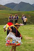 Traditional Inca Dancers in costume, Inca terraces of Moray,  Cusco Region, Urubamba Province, Machupicchu District, Peru