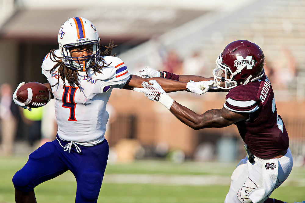 STARKVILLE, MS - SEPTEMBER 19:  Daniel Taylor #4 of the Northwestern State Demons stiff arms Will Redmond #2 of the Mississippi State Bulldogs at Davis Wade Stadium on September 19, 2015 in Starkville, Mississippi.  The Bulldogs defeated the Demons 62-13.  (Photo by Wesley Hitt/Getty Images) *** Local Caption *** Daniel Taylor; Will Redmond