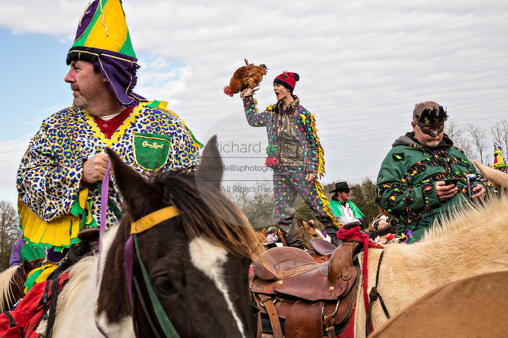 Costumed revelers dance on their horses during the Mamou Courir de Mardi Gras chicken run on Fat Tuesday February 17, 2015 in Mamou, Louisiana. The traditional Cajun Mardi Gras involves costumed revelers competing to catch a live chicken as they move from house to house throughout the rural community.